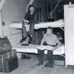Students studied on bunk bets in this barracks-style dorm in 1945. <span class=