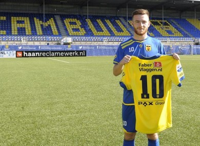 Jack Byrne poses with his new jersey.