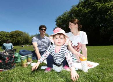 Simon, Rebecca and Charlotte McCafferty enjoy the sunshine yesterday