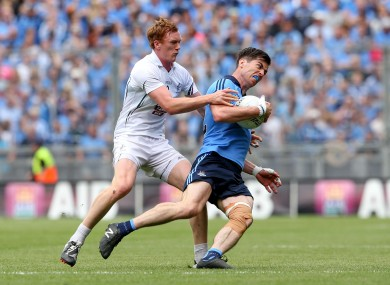Kildare's Paul Cribbin and Dublin's Michael Darragh MacAuley.