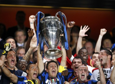 Inter Milan Defender Javier Zanetti Holds Up The Cup With His Team After Winning Champions