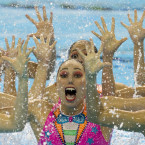 Members of Mexico's synchronised swimming team perform a clown inspired number for their free routine at the Pan Am Games in Toronto, Saturday, July 11, 2015. Mexico won silver in the event.<span class=