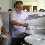 American film director Francis Ford Coppola adds salt to boiling water in the kitchen of the International School of Film and Television in San Antonio de Los Banos, near Havana, Cuba, Thursday, July 16, 2015. Coppola who is on a visit to Cuba, met and interacted with students at the school, and prepared a pasta meal for the students. <span class=