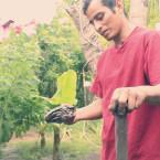 Pablo Ramirez, President of La Tiarna, demonstrates how to trap a crab, an economic staple of the community.