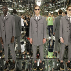 Models stand in a mirrored room during a presentation by Thom Browne at Men's Fashion Week in New York, Tuesday, July 14, 2015. The inaugural New York Men's Fashion Week runs through Thursday. <span class=