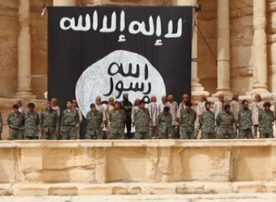 In a clip from the video, teen soldiers line up behind Syrian military members, shortly before they execute them.