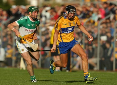 Shane Golden gets away from Offaly's Eanna Murphy.