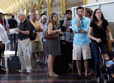 People queuing at Washington's Reagan National Airport yesterday