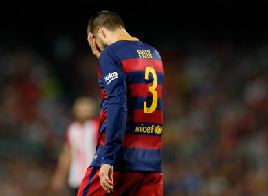 Pique leaves the pitch after being shown a red card.