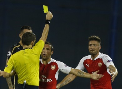 Olivier Giroud is shown a second yellow card.
