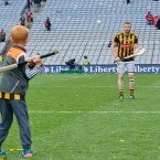 Kilkenny's Richie Power savoured the All-Ireland title with a puck around with his son Rory.<span class=