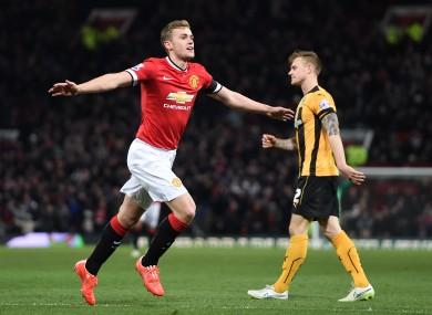 Wilson celebrates scoring against Cambridge United in the FA Cup in February.