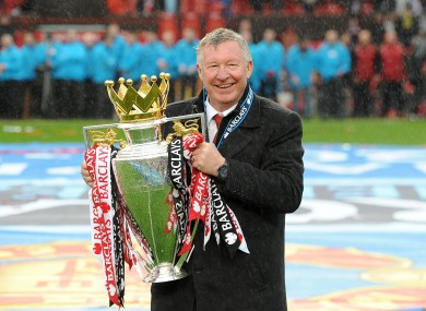 Manchester United manager Sir Alex Ferguson celebrates with the Barclays Premier League trophy in 2013.