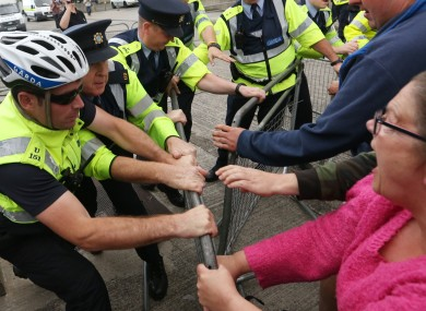 Anti water charge protesters struggle with gardaí at an event in Dublin last month.
