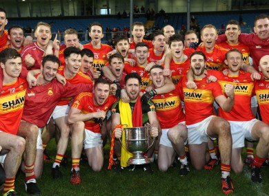 Castlebar Mitchels players celebrate with the cup.