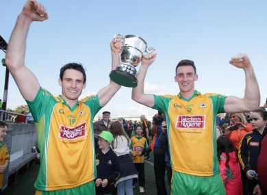 Corofin's Kieron Molloy and Ciaran McGrath celebrate with the Frank Cox Cup.