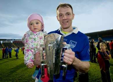 Lar Corbett of Thurles Sarsfields and his daughter Faye with the cup after the game.