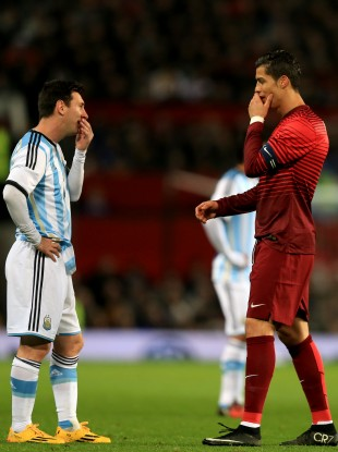 Ronaldo and Messi chat during an international friendly at Old Trafford.
