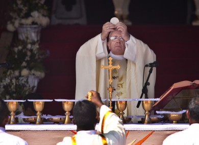Pope Francis prepares for the Holy Communion.