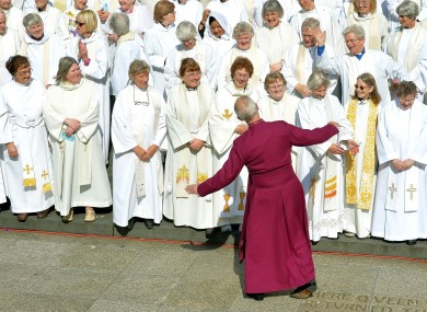 Archbishop of Canterbury Justin Welby joins women earlier this year to mark the 20th anniversary of the Church of England's first ordination of female priests.