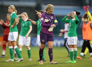 The Irish players looking dejected at full-time yesterday.