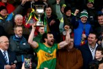 Clonmel captain Kevin Harney leads the celebrations.