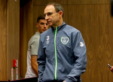 O'Neill arriving for today's press conference alongside Ciaran Clark.