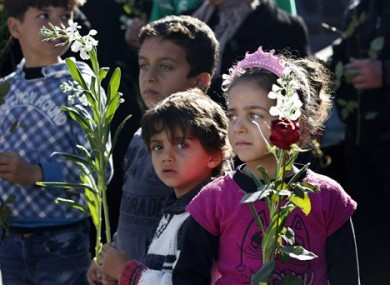 Families of wounded Syrian opposition fighters wait for their release at the Lebanese border crossing point of Masnaa.