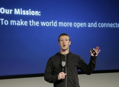 Facebook CEO Mark Zuckerberg with the company's mission statement in 2013