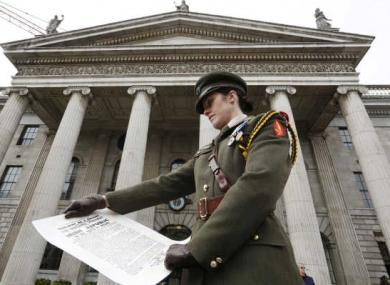 Irish Army Captain Kate Hanrahan with the Irish Republic proclamation at the official commemoration of the 1916 Easter Rising Commemoration Ceremony at the GPO on O'Connell Street, Dublin earlier this year.