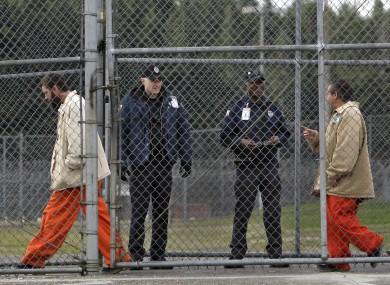 Inmates walk past correctional officers at the Washington Corrections Centre (File photo)