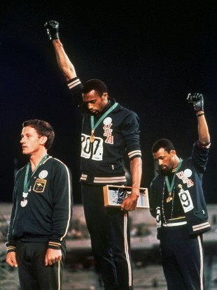 Australian silver medalist Peter Norman is at left in the famous photo.