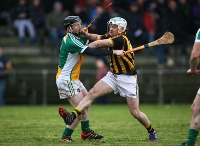 Offaly's Niall Wynne puts up a roadblock for Kilkenny's Jonjo Farrell