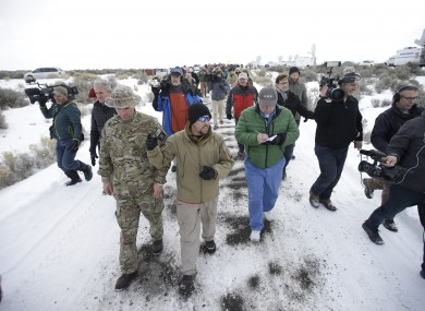 Members of the group occupying the Malheur National Wildlife Refuge headquarters, left, conduct a tour with the media.