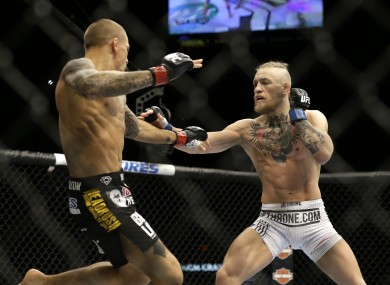 Dustin Poirier and Conor McGregor in action during their September 2014 bout in Las Vegas.