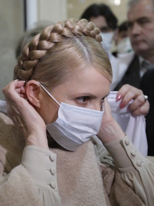 The then Ukrainian prime minister Yulia Tymoshenko in 2010 wearing a mask to protect against Swine flu