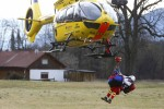 A German rescue helicopter lands with an injured person.