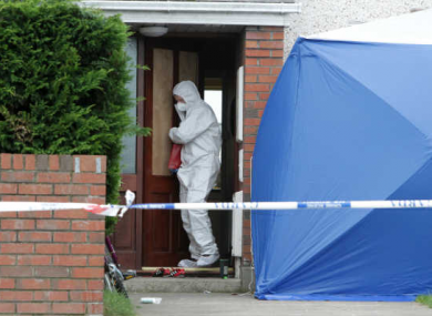 Forensic teams search the scene of the stabbing to death of Michael Gannon.