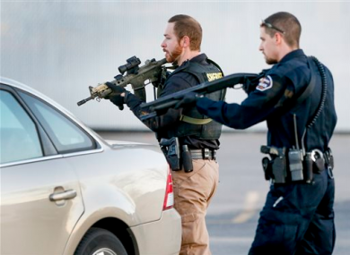 Police look for a possible second shooter in the parking lot of Excel Industries.