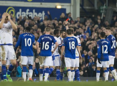 Chelsea's Diego Costa, centre right, is shown a red card by referee Michael Oliver.
