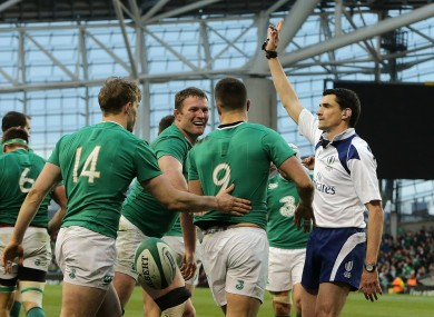 Conor Murray celebrates his try with Andrew Trimble and Donnacha Ryan.