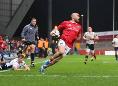 Munster's Simon Zebo runs in for a try.