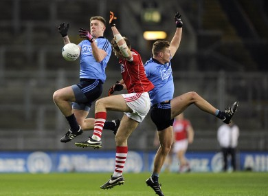 Dublin's Shane Carthy and Ciaran Kilkenny battling for the ball with Cork's Ian Maguire.