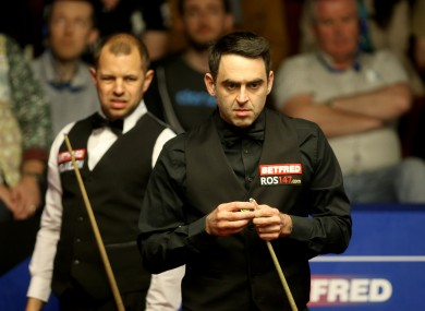Barry Hawkins and Ronnie O'Sullivan (right) during day nine of the Betfred Snooker World Championships at the Crucible..