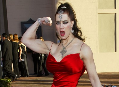 In this Nov. 16, 2003, file photo, Joanie Laurer, former pro wrestler known as Chyna, flexes her bicep as she arrives at the 31st annual American Music Awards.