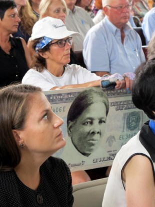 A campaigner with a mock-up of a Tubman $20 bill.