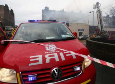 Firemen from Dublin fire brigade fight a fire in a property on Fitzgibbon Lane in Dublin.