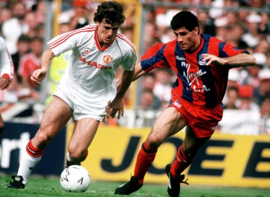 Mark Hughes takes on Crystal Palace's Gary O'Reilly in the 1990 final.