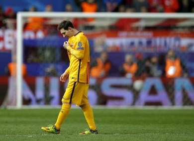Lionel Messi walks on the pitch during the Champions League second leg quarter-final match between Atletico Madrid and Barcelona.