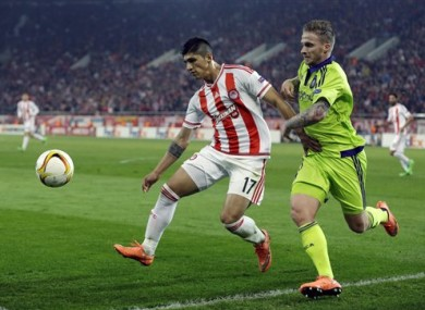 Olympiakos' Alan Pulido, left, fights for the ball with Anderlecht's Alexander Buttner during a Europa League match in February.